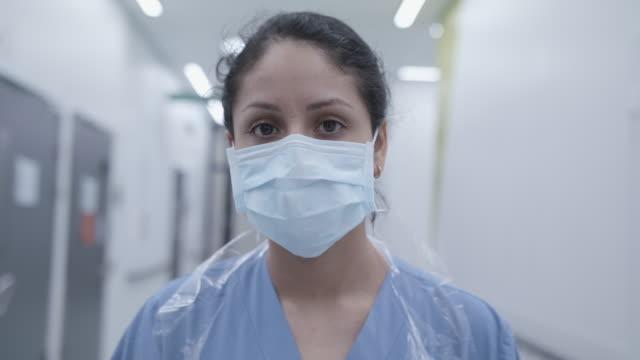 Corona virus pandemic in Sweden. Nurse wearing mask in corridor.