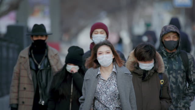 Corona Virus. Wear Respiratory Protect Face Mask. City Street Crowd Walk real. video