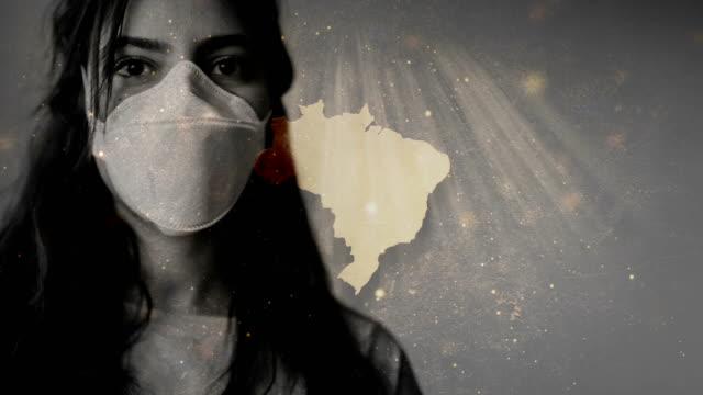 coronavirus 2019-ncov novel coronavirus concept motion background, patience with protective mask and brazil map overlay. - латинская америка стоковые видео и кадры b-roll