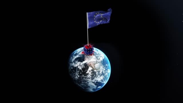 コロナウイルスcovid-19は欧州連合(eu)に敗北し、欧州連合(eu)旗は4k決議で回転する地球儀で取り壊されたウイルスの上に手を振っています - 全壊点の映像素材/bロール