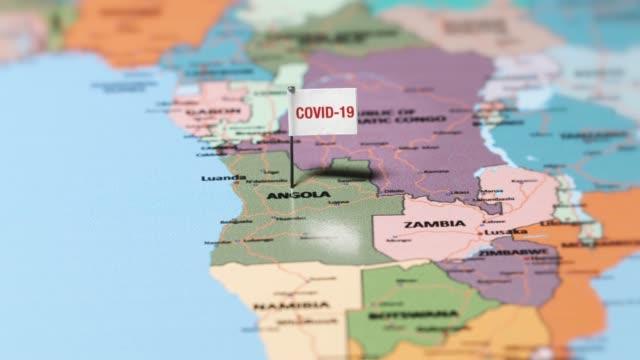 коронавирусный флаг на анголе. - линия экватора стоковые видео и кадры b-roll