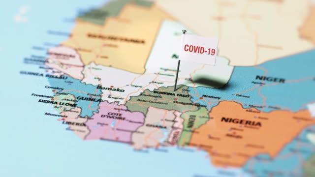 коронавирусный флаг на буркина-фасо - линия экватора стоковые видео и кадры b-roll