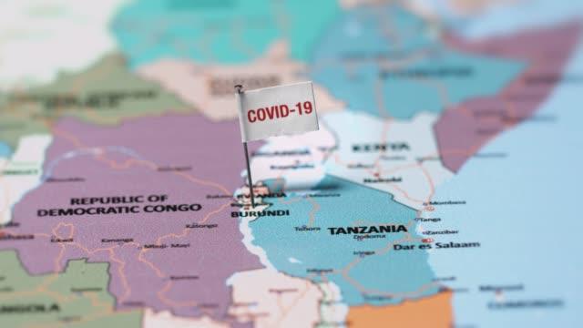 коронавирусный флаг на бурунди. - линия экватора стоковые видео и кадры b-roll