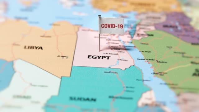 коронавирусный флаг на египте. - линия экватора стоковые видео и кадры b-roll