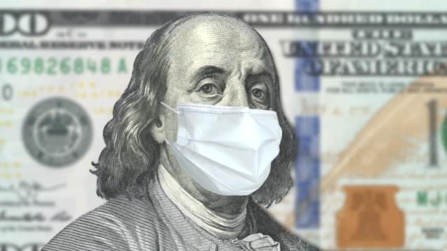 COVID-19 Coronavirus in den USA, 100-Dollar-Geldschein mit Gesichtsmaske – Video
