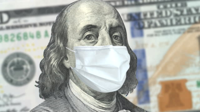 COVID-19 coronavirus in USA, 100 dollar money bill with face mask Coronavirus affects global stock market. World economy hit by corona virus outbreak and pandemic fears. Crisis and finance concept. economy stock videos & royalty-free footage