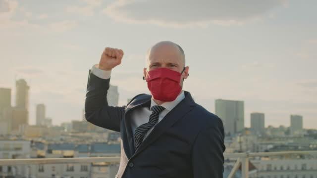 Coronavirus pandemic. Businessman conquering pandemic world