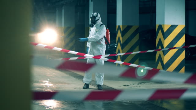 Coronavirus prevention, covid-19 protective disinfection. Man with a sprayer disinfects restricted zone. Man with a sprayer disinfects restricted zone. 4K time zone stock videos & royalty-free footage