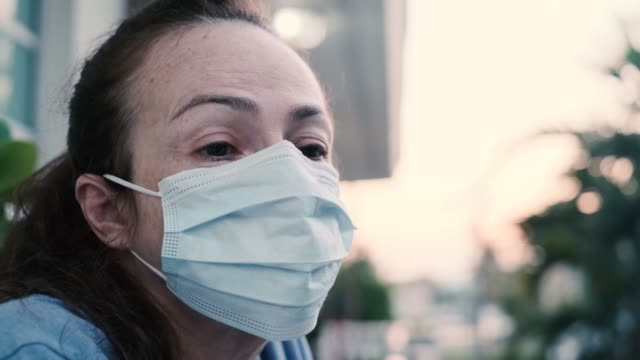 Coronavirus prevention. Woman wearing protective mask. Worried expression.