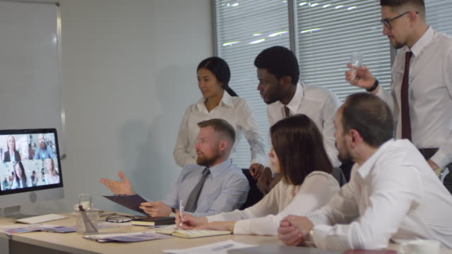 Bидео Corporate Associates Having Video Call Meeting with Colleagues