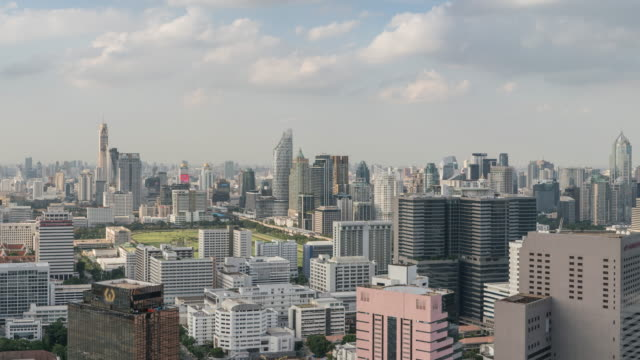 corporate building of bangkok skyline, tilt down - tilt down stock videos & royalty-free footage