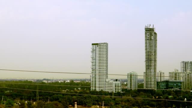 corporate business building in gurugram, haryana, india - haryana video stock e b–roll