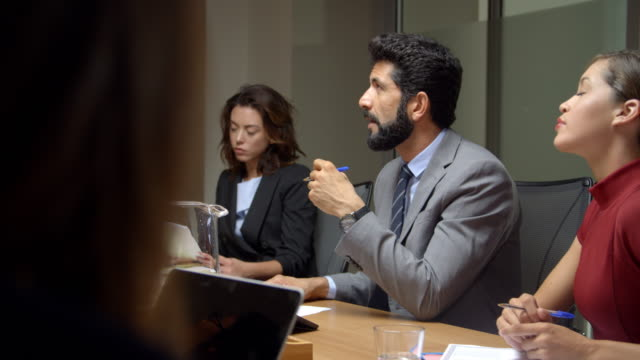 Corporate business colleagues at a boardroom meeting video