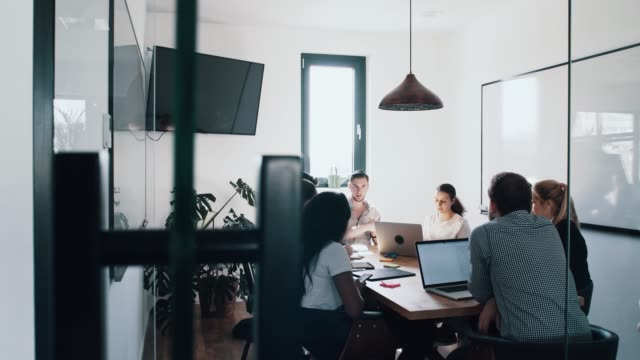 Corporate business team in discussion in a meeting cubicle Corporate business team in discussion in a meeting cubicle cube stock videos & royalty-free footage