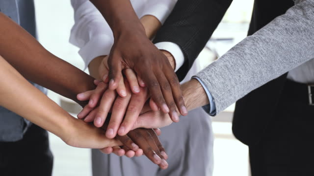 Video Corporate business team people stack hands together in pile, closeup