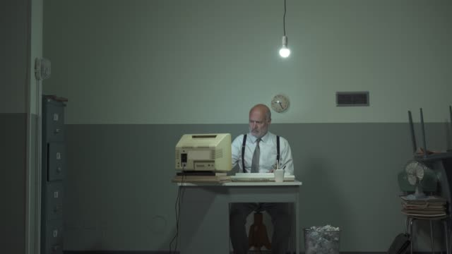 Corporate businessman hitting his outdated computer Corporate businessman working in a rundown office and hitting his outdated computer obsolete stock videos & royalty-free footage