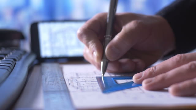 Corporate Engineer working with architect construction design blueprints video