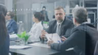 istock Corporate Meeting Room: Senior Executive Delivers Powerful Speech About Company's Record Breaking Annual Revenue Results to a Board of Directors, Investors, Lawyers. Achieving Great Results 1146456244
