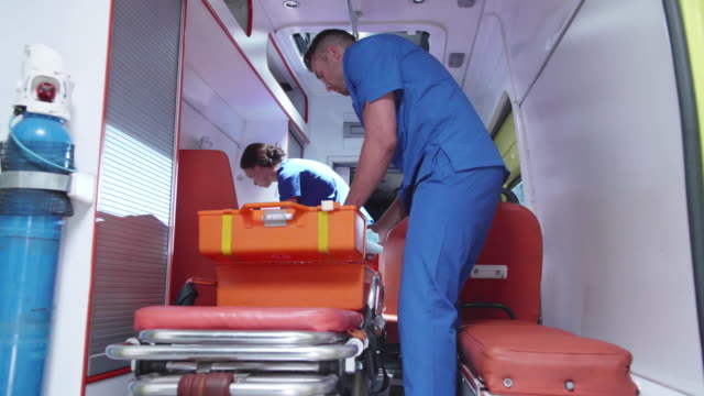 corpsman and nurse pack equipment in ambulance car - paramedic stock videos & royalty-free footage