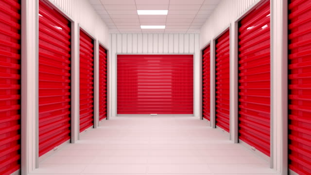 Corridor full of storage units with red door and siding panels on walls. video