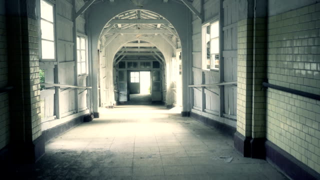 Corridor in abandoned psychiactric hospital Corridor in abandoned psychiactric hospital abandoned stock videos & royalty-free footage