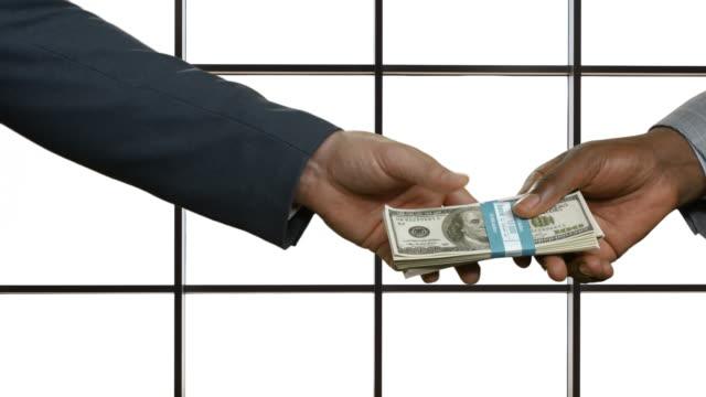 vídeos de stock e filmes b-roll de corrompido promoções. homem transmitir dinheiro ao empresário. - corruption