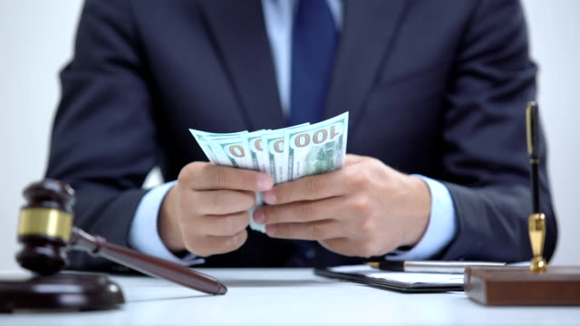 Corrupt lawyer hiding bribe money in jacket, signing illegal business agreement Corrupt lawyer hiding bribe money in jacket, signing illegal business agreement legal trial stock videos & royalty-free footage