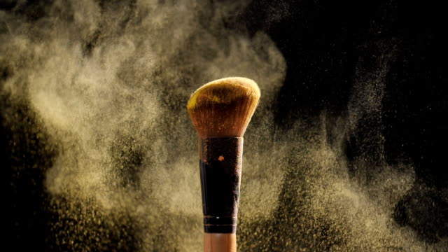 cosmetic brush with golden cosmetic powder for make up - make up stock videos & royalty-free footage