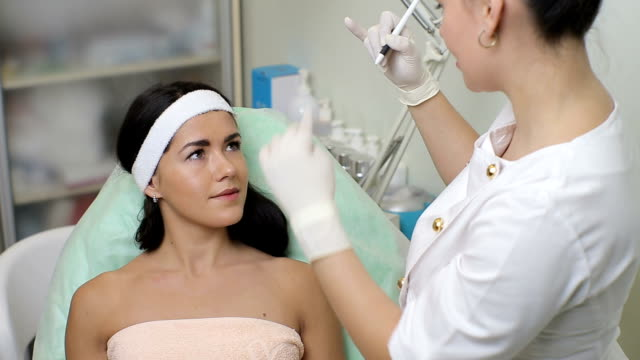 Cosmetologist prepares woman face to botox injections video