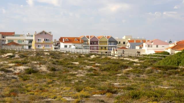 vídeos de stock e filmes b-roll de costa nova beautiful colorful white stripes buildings in aveiro, portugal - aveiro