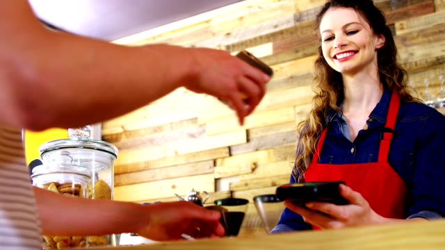 Costumer paying bill through smartphone using NFC technology video
