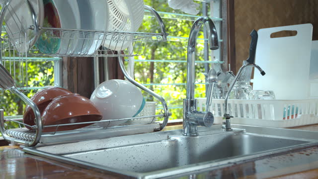 Cottage wood kitchen clean interior design with sink and houseware