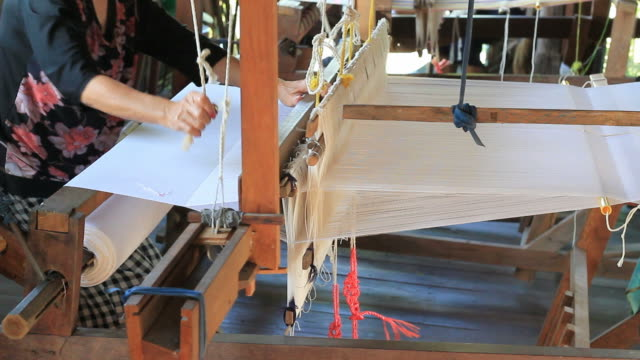 Cotton weaving on a loom video