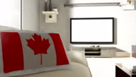 istock Couch and TV With Canadian Flag 1043275618
