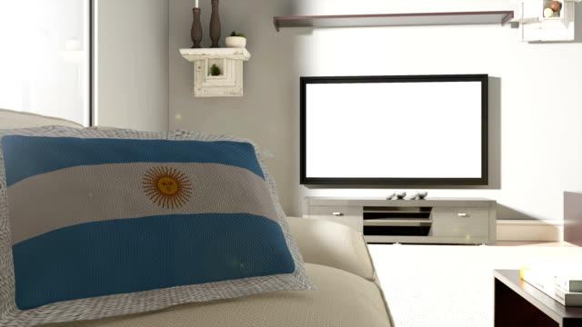 Sofá y TV con la bandera de Argentina - vídeo