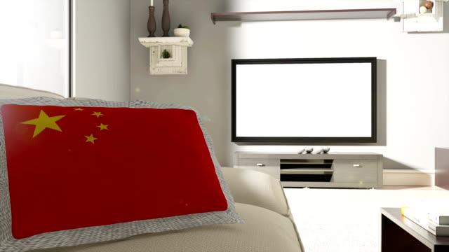 Sofá y TV con la bandera de China - vídeo