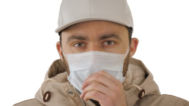 Coughing casual man in medical mask on white background Close up. Coughing casual man in medical mask on white background. Professional shot in 4K resolution. 53. You can use it e.g. in your medical, commercial video, business, presentation, broadcast emphysema stock videos & royalty-free footage