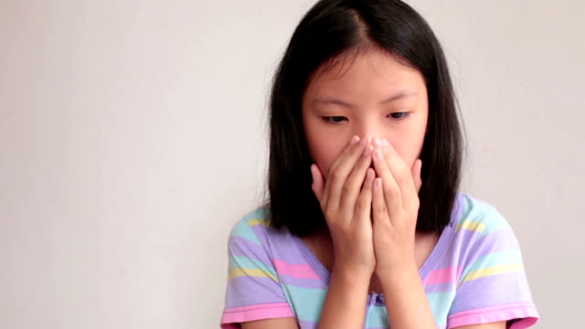 Coughing, Flu, Covering with Medical Mask Asian girl is coughing with a head cold, the flu, or allergies.  coughing stock videos & royalty-free footage
