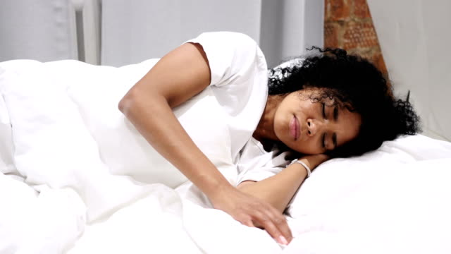 Coughing Sick Afro-American Woman in Bed at Night, Throat Infection, Lying on Side video
