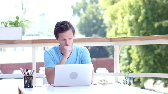 Coughing Young Man at Work, Sitting Outdoor Coughing Young Man at Work, Sitting Outdoor, creative desiner emphysema stock videos & royalty-free footage