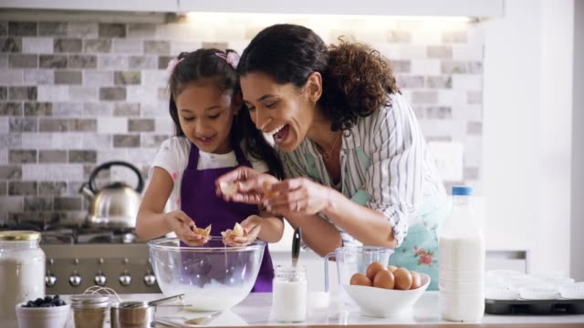 Count the memories not the calories 4k footage of a mother and daughter spending quality time while baking at home hobbies stock videos & royalty-free footage