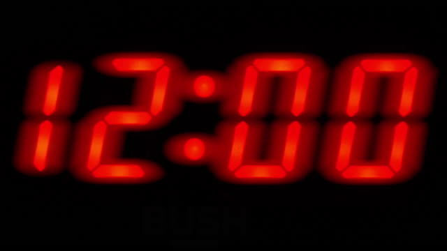 Countdown to midnight. Digital numbers. Counting down from 10.00 until 12.00 midnight. Digital numbers timelapse and pulsating number when the time hits 12.00. -also available with fireworks and without pulsating numbers. time zone stock videos & royalty-free footage