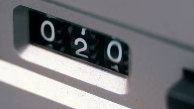 counter of the audio cassette in the tape deck recorder is rotating - cassetta video stock e b–roll