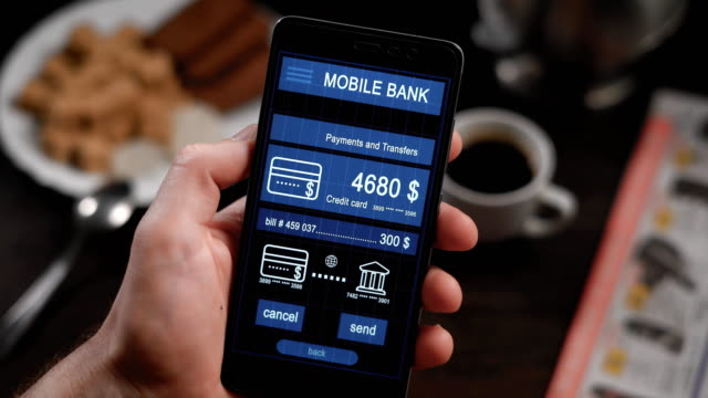 Counter payment via mobile banking application on the smartphone. A man transfers money from his credit card to another person video