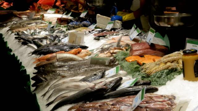 Counter with Seafood in La Boqueria Fish Market. Barcelona. Spain video