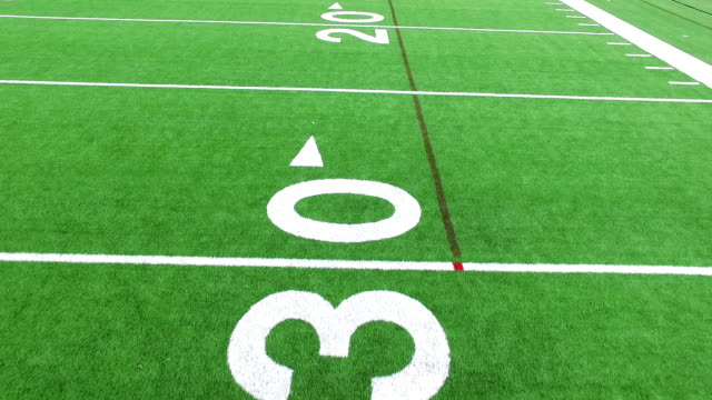 Counting Down Yard Lines close to Green Astro Turf Football Field video
