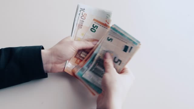 Counting euro banknotes by hand A person is counting euro banknotes one by one.A person is counting euro banknotes one by one. european union currency stock videos & royalty-free footage