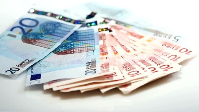 counting euro banknotes - financial concept - valuta dell'unione europea video stock e b–roll