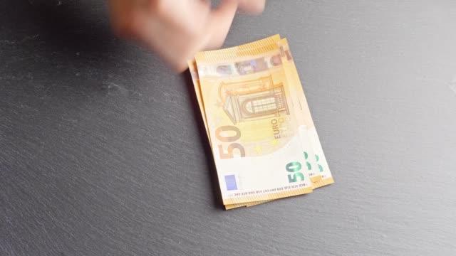counting -euro-banknotes - simbolo dell'euro video stock e b–roll