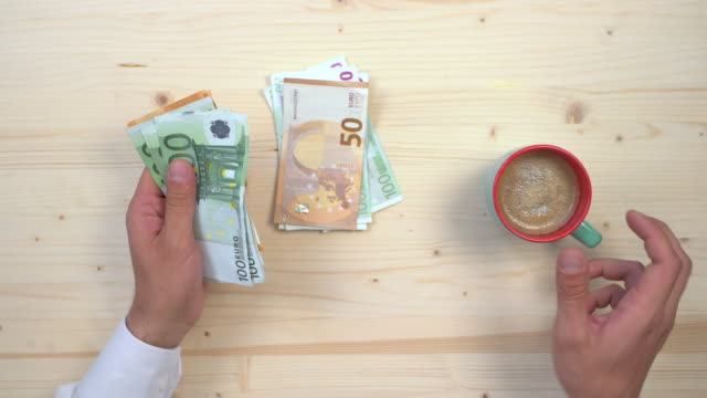 Counting euros and drinking coffee
